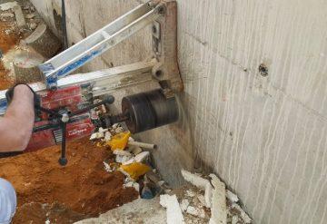 קידוח פתח בחומת בטון