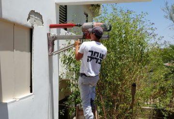 קידוח פתח בקיר בטון בבית פרטי